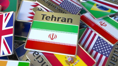 Souvenir magnet or badge with Tehran text and national flag among different ones. Traveling to Iran conceptual 3D rendering