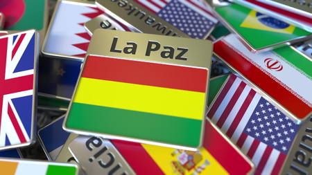 Souvenir magnet or badge with La Paz text and national flag among different ones. Traveling to Bolivia conceptual 3D rendering Stockfoto