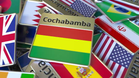 Souvenir magnet or badge with Cochabamba text and national flag among different ones. Traveling to Bolivia conceptual 3D rendering Фото со стока