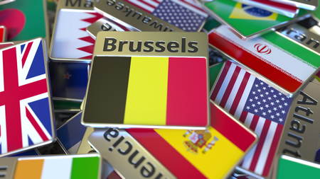 Souvenir magnet or badge with Brussels text and national flag among different ones. Traveling to Belgium conceptual 3D rendering