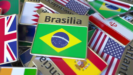 Souvenir magnet or badge with Brasilia text and national flag among different ones. Traveling to Brazil conceptual 3D rendering