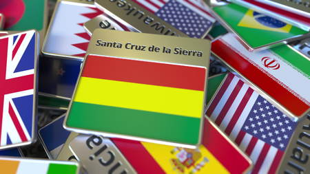 Souvenir magnet or badge with Santa Cruz de la Sierra text and national flag among different ones. Traveling to Bolivia conceptual 3D rendering