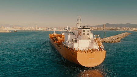 LIVORNO, ITALY - JANUARY 2, 2019. Aerial shot of Stolt Alm oil tanker near port of Livorno