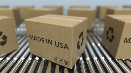 Boxes with MADE IN USA text on roller conveyor. American goods related 3D rendering