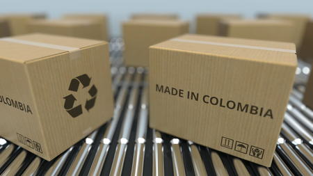 Boxes with MADE IN COLOMBIA text on roller conveyor. Colombian goods related 3D rendering