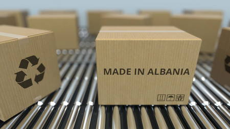 Boxes with MADE IN ALBANIA text on roller conveyor. Albanian goods related 3D rendering