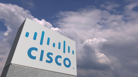 Logo of CISCO on a stand against cloudy sky, editorial 3D rendering