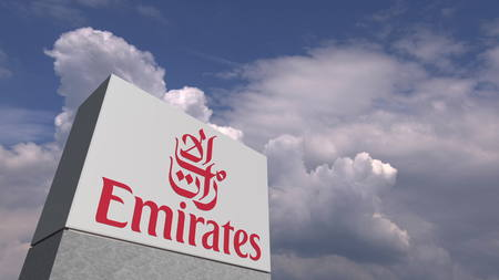 EMIRATES AIRLINES logo against sky background, editorial 3D rendering 報道画像