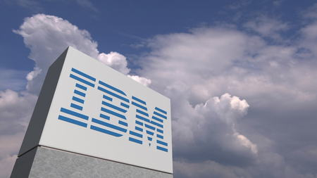 Logo of IBM on a stand against cloudy sky, editorial 3D rendering