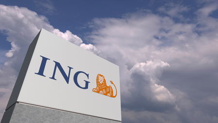 Logo of ING on a stand against cloudy sky, editorial 3D rendering