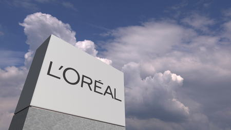 Logo of LOREAL on a stand against cloudy sky, editorial 3D rendering