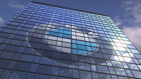 Logo of BMW on a media facade with reflecting cloudy sky, editorial 3D rendering Editorial