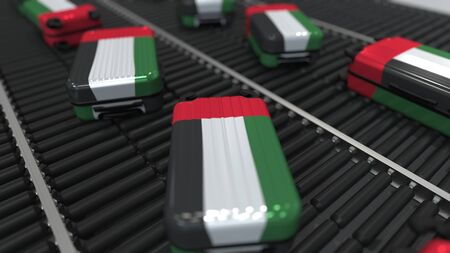 Many travel suitcases featuring flag of the United Arab Emirates on roller conveyer. UAE tourism conceptual 3D rendering