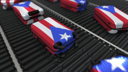Many travel suitcases featuring flag of Puerto Rico on roller conveyer. Puerto Rican tourism conceptual 3D rendering Foto de archivo