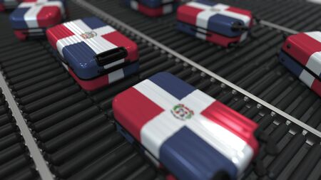Many travel suitcases featuring flag of the Dominican Republic on roller conveyer. Tourism related conceptual 3D rendering