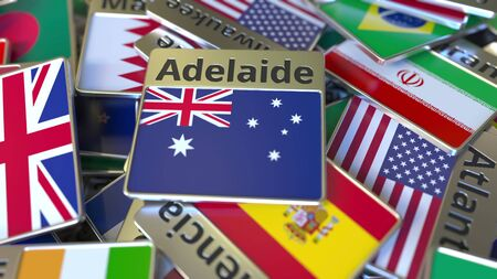 Souvenir magnet or badge with Adelaide text and national flag among different ones. Traveling to Australia conceptual 3D rendering Фото со стока