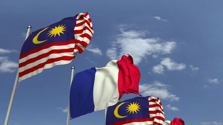 Flags of Malaysia and France against blue sky, 3D rendering