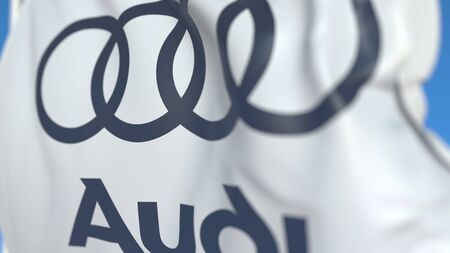 Waving flag with Audi logo, close-up. Editorial 3D rendering