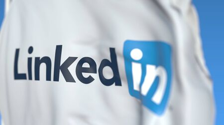 Waving flag with LinkedIn Corporation logo, close-up. Editorial 3D rendering