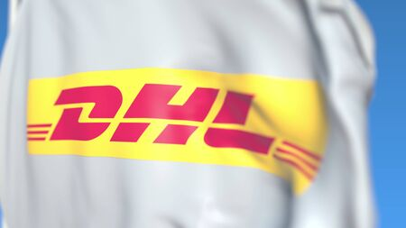 Waving flag with DHL International GmbH logo, close-up. Editorial 3D rendering Editorial