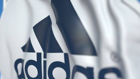 Waving flag with Adidas logo, close-up. Editorial 3D rendering