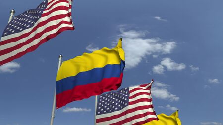 Flags of Colombia and the USA against blue sky, 3D rendering 版權商用圖片