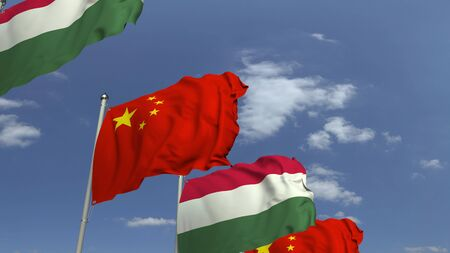 Row of waving flags of Hungary and China, 3D rendering Фото со стока