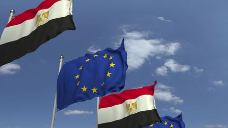 Flags of Egypt and the European Union against blue sky, 3D rendering