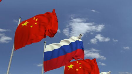 Flags of Russia and China against blue sky, 3D rendering
