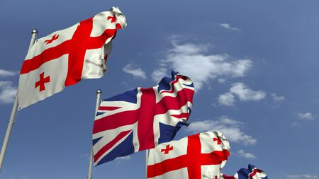 Flags of Georgia and the United Kingdom against blue sky, 3D rendering Stock fotó