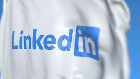 Flag with LinkedIn Corporation logo, close-up. Editorial 3D rendering