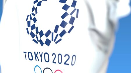 Flag with Games of the XXXII Olympiad or 2020 Summer Olympics in Tokyo logo, close-up. Editorial 3D rendering