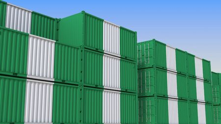 Container yard full of containers with flag of Nigeria. Nigerian export or import related 3D rendering Stock Photo