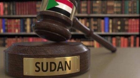 Flag of Sudan on falling judges gavel in court. National justice or jurisdiction related conceptual 3D rendering Stockfoto
