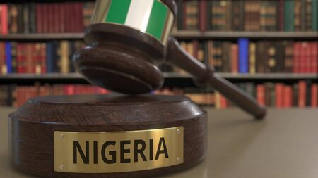 Flag of Nigeria on judges gavel in court. National justice or jurisdiction related conceptual 3D rendering Stock Photo