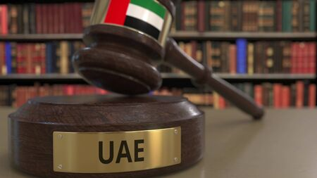 Flag of the United Arab Emirates UAE on judges gavel in court. National justice or jurisdiction related conceptual 3D rendering