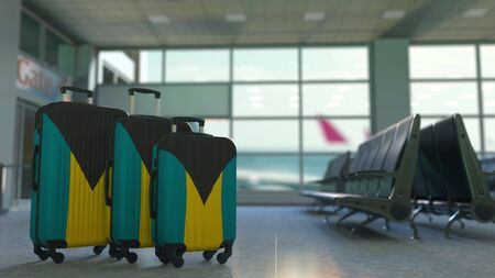 Travel suitcases with flag of Bahamas. Bahamian tourism conceptual 3D rendering