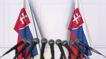 Slovak official press conference. Flags of Slovakia and microphones. Conceptual 3D rendering Banque d'images - 128901261