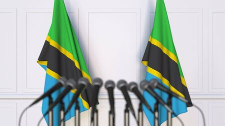 Tanzanian official press conference. Flags of Tanzania and microphones. Conceptual 3D rendering Banque d'images - 128901101
