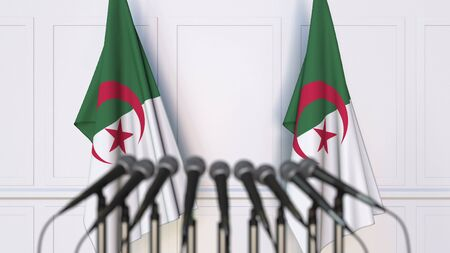 Algerian official press conference. Flags of Algeria and microphones. Conceptual 3D rendering Banque d'images - 128901125