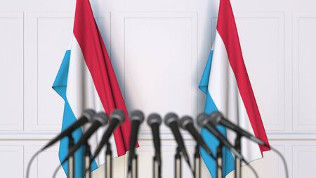 Luxembourgian official press conference. Flags of Luxembourg and microphones. Conceptual 3D rendering Banque d'images - 128901137