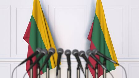 Lithuanian official press conference. Flags of Lithuania and microphones. Conceptual 3D rendering Banque d'images - 128901126