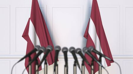 Latvian official press conference. Flags of Latvia and microphones. Conceptual 3D rendering Banque d'images - 128901127