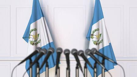 Guatemalan official press conference. Flags of Guatemala and microphones. Conceptual 3D rendering Banque d'images - 128901129