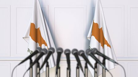 Cypriot official press conference. Flags of Cyprus and microphones. Conceptual 3D rendering Banque d'images - 128901124