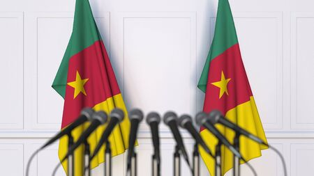 Cameroonian official press conference. Flags of Cameroon and microphones. Conceptual 3D rendering Banque d'images - 128900957