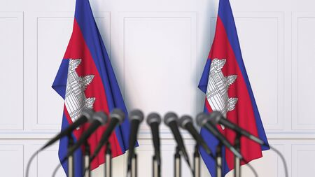 Cambodian official press conference. Flags of Cambodia and microphones. Conceptual 3D rendering Banque d'images - 128900964