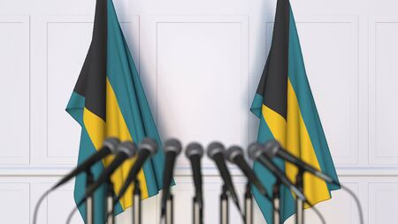 Bahamian official press conference. Flags of the Bahamas and microphones. Conceptual 3D rendering Banque d'images - 128900966