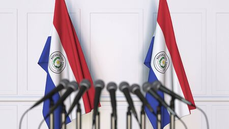 Paraguayan official press conference. Flags of Paraguay and microphones. Conceptual 3D rendering Banque d'images - 128900962