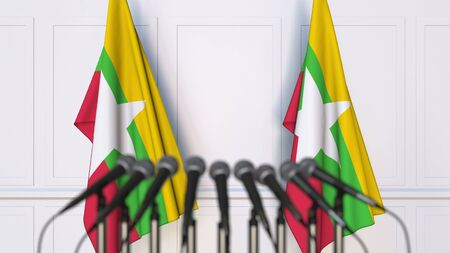 Myanma official press conference. Flags of Myanmar and microphones. Conceptual 3D rendering Banque d'images - 128900961